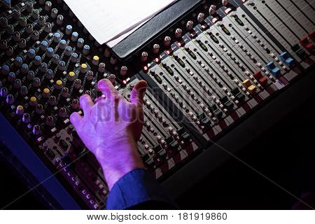 Sound Mixer. Professional Audio Mixing Console With Lights, Buttons, Faders And Sliders. With Hand