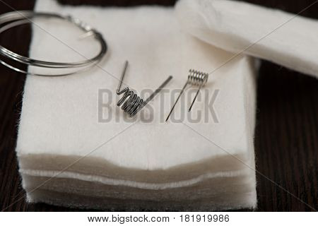 Spare Parts For Winding Vaping With Cotton On A Black Background Closeup Isolated