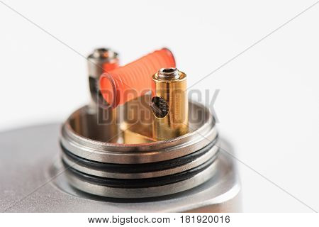 Vaping Device With A Hot Spring On A White Background For Evaporation
