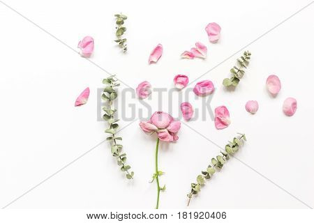 Spring trendy disign with flowers petals on white woman table background top view mock up