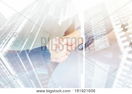 Double exposure of Close up businesswoman and businessman handshake with cityscape building Business partnership concept.