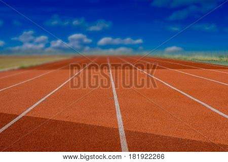 Red Running track with corner of the football field.
