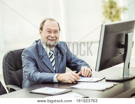 businessman working with financial graphs in the workplace .the photo has a empty space for your text