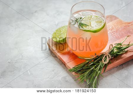 healthy morning with fresh drink, sliced lime and rosemary on stone table background mockup