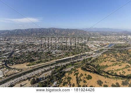 Aerial view of the Ventura 134 freeway, Griffith Park and the Los Angeles River in Southern California.