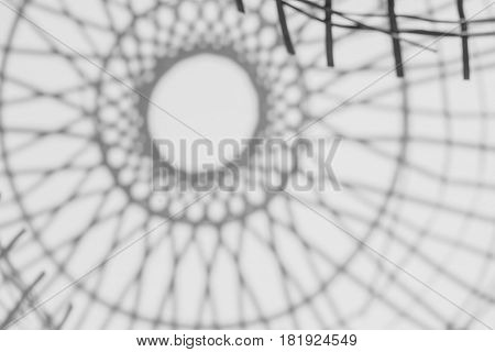 abstract background of shadows Bamboo basketry on a white wall.