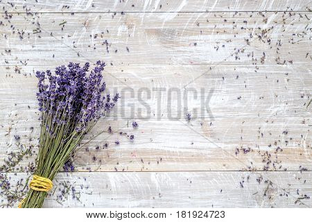 laveder composition with dry bouquet on rustic desk background top view space for text