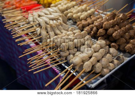 Thai meat ball and sausage with bamboo stick Thai food on street food prepared or cooked food sold by vendors