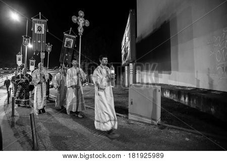 PORTO, PORTUGAL - APR 16, 2017: Night Easter procession during celebrations of Orthodox Easter in Parish of Sainted New Martyrs and Confessors of Russia at Russian Orthodox Church (black and white)