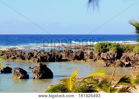 Scenic rock formations, Rota, Northern mariana Islands Rock formations with the waves rolling against the reef in Songsong, Rota