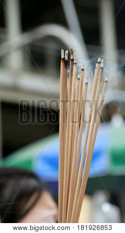 lighted brown incense sticks Incense sticks are usually lighted by worshipers in temples, churches and in shrines