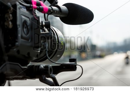 BERLIN - APRIL 02 2017: The annual 37th Berlin Half Marathon. A videographer at work. Camera close-up. The background is out of focus.