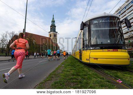 BERLIN - APRIL 02 2017: The annual 37th Berlin Half Marathon. Athletes run on Karl-Liebknecht-Strasse (Karl Liebknecht Street).