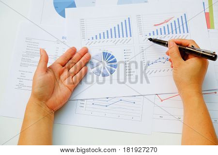 Asian business meeting dicuss analysis report view from top. concept of business analysis data analysis.