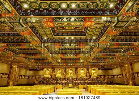 Golden Buddha Statues In Interior Of The Temple
