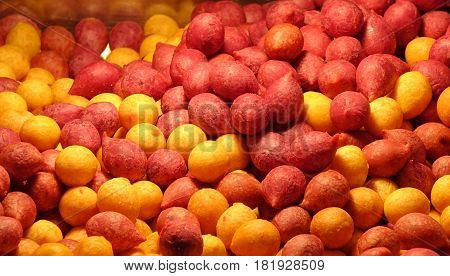 Sweet potato balls in red and yellow a popular street food in Taiwan