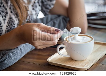 Cup Of Capuchino Coffee With Woman And Spoon