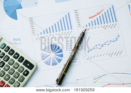 Desk office with pen analysis report calculator. view from top. concept of business analysis data analysis.