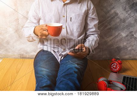 Man's Using Smart Phone With Cup Of Fresh Coffee