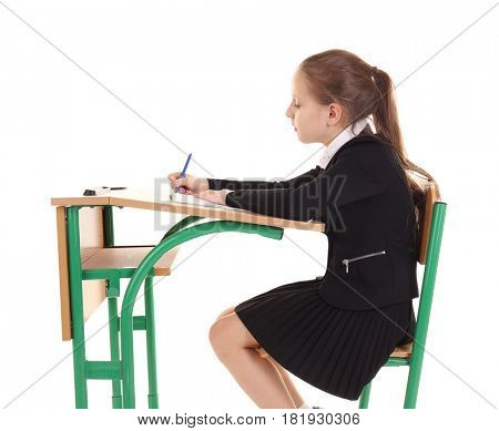 Incorrect posture concept. Schoolgirl sitting at desk on white background