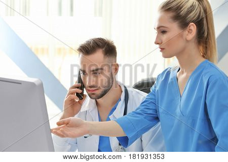 Doctor and medical assistant in office
