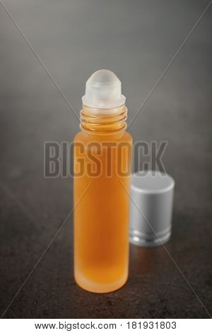 Open bottle with perfume on grunge background
