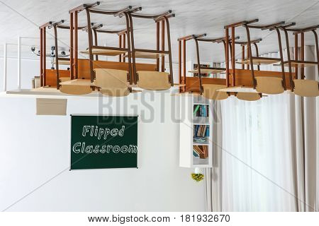 Flipped classroom concept. Inversed interior of school room