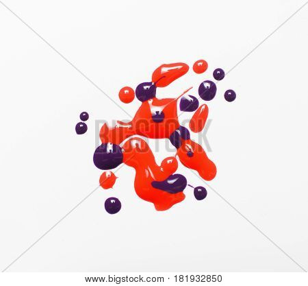 Abstractionism, creative modern painting. Bright glossy shiny texture, liquid red and purple nail polish drops isolated on white background. Creative abstract art.