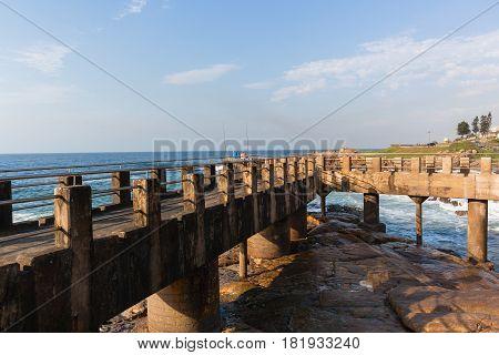Ocean rocky coastline pier fishing jetty landscape