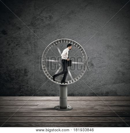 Businessman running on the hamster wheel. looping life concept
