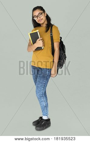 Indian girl student smiling and holding textbook