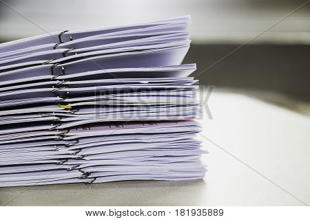 Pile of unfinished documents on office desk Stack of business paper poster