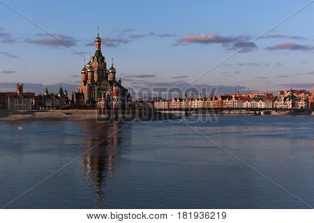 Yoshkar-Ola, Russia - April 16, 2017 Photo of a view on the embankment of the city of Yoshkar-Ola, which is the Cathedral of the Annunciation of the Holy Virgin