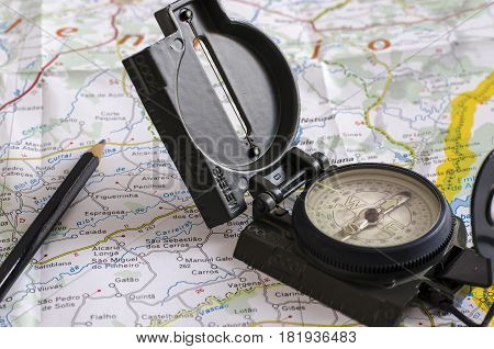 still life with a compass and over a map. travel. journey. tourism. direction.