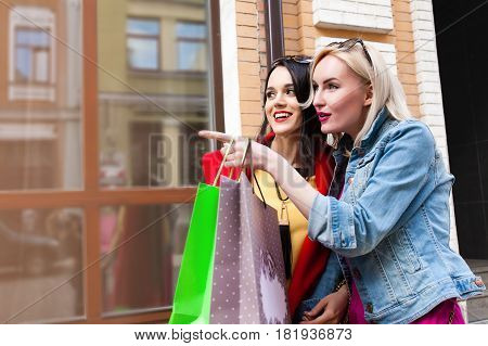 sale and tourism, happy people concept - beautiful women a With shopping bags