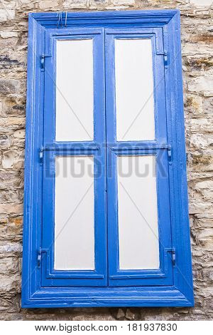 Window with white shutters. Windows are closed