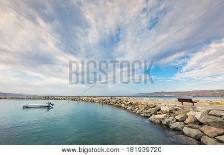 Walking stone pier at the central public beach in Eilat - Israeli southernmost tourist and resort city, located on the northern shores of the Red Sea