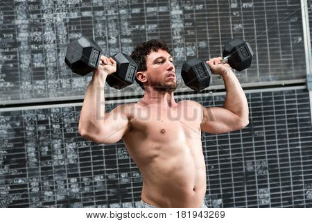 Muscular Athlete Doing Weights Training