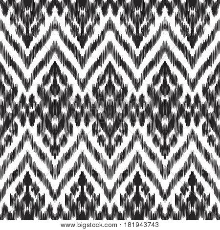 Vector illustration of the black and white colored ikat ornamental seamless pattern. Scribble texture. Design in ethic style.