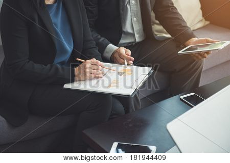 Team work process. young business managers crew working with new startup project. labtop on wood table typing keyboard texting message analyze graph plans.