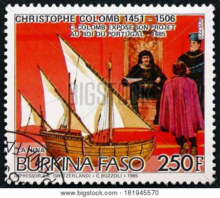 BURKINA FASO - CIRCA 1986: a stamp printed in Burkina Faso shows Christopher Columbus at Court of King of Portugal and the Nina circa 1986