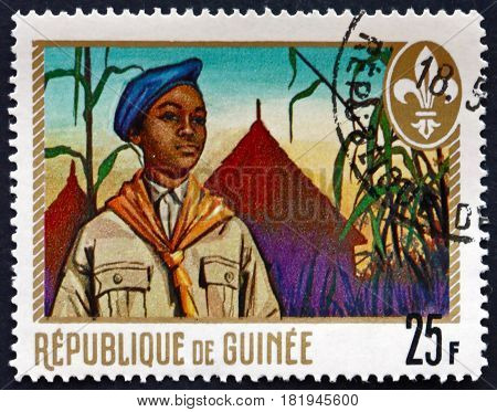 GUINEA - CIRCA 1969: a stamp printed in Guinea shows Boy Scout and Tents Boy Scouts of Guinea circa 1969