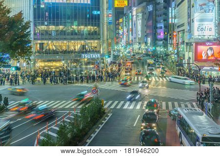 Tokyo Japan - November 20 2016 :Pedestrians cross at Shibuya Crossing in raining day in Tokyo Japan.