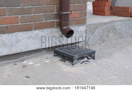 Rain gutter downspout drainage installation. Gutter Downspout for Better Home Drainage.