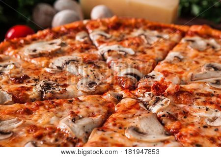 Appetizing hot sliced italian pizza, closeup view. Fast food restaurant menu photo. Traditional meal, unhealthy eating concept