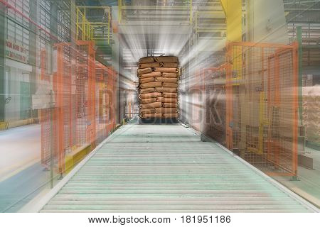 Packaging production line, Plastic resins in paper bag on pallet.
