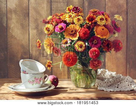 country still life with flowers and dishes