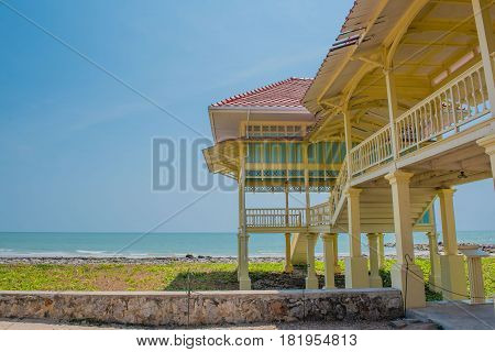 Summer Wood pavilion seaside on blue sky background.