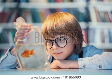 Boy makes a wish indoors