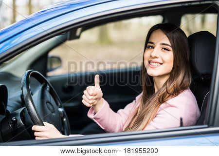 Beautiful Businesswoman Giving Thumb Up Inside Her Car